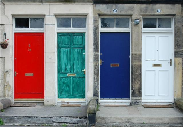 four differently colored front doors