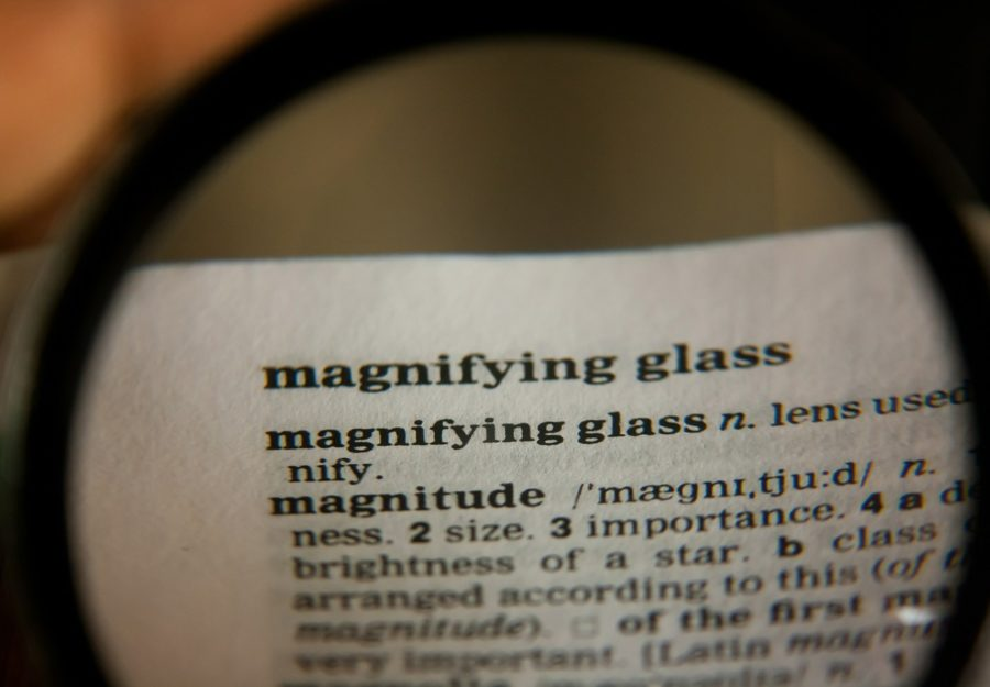 """definition of """"magnifying glass"""" read with a magnifying glass."""