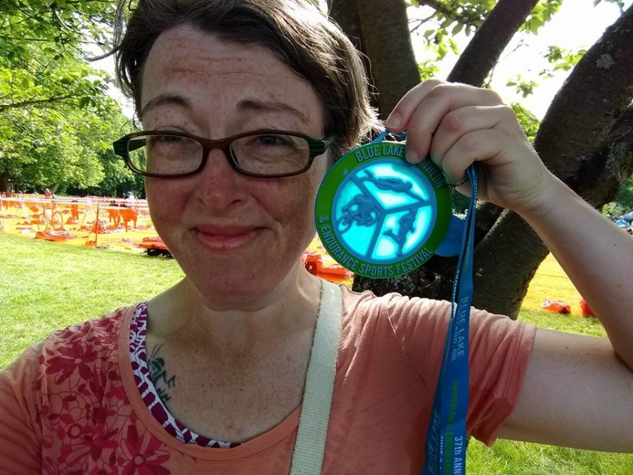 me holding a spring triathlon medal